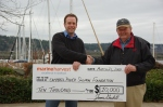 Jamie Gaskill of MHC presenting $10 000 donation to Mike Gage of the Campbell River Salmon Foundation